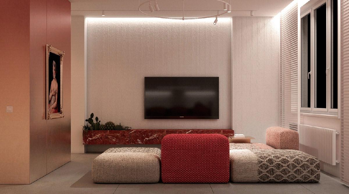 Bên dưới chiếc tivi màn hình phẳng, màu đỏ tiếp tục hiện diện ở đá cẩm thạch thay thế cho kệ tivi. Đặc biệt, một phần của kệ đá được biến tấu thành chỗ trồng cây - một cách làm rất hay và đáng học hỏi.