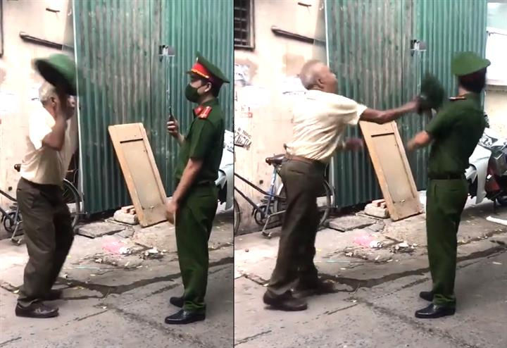 Hà Nội: Không đeo khẩu trang bị nhắc nhở, cụ ông vụt mũ cối thẳng mặt công an - 1